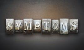 Symptoms Letterpress. The word SYMPTOMS written in vintage letterpress type Royalty Free Stock Photo