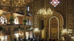 Synagogue. Interior - lit chandeliers and flowers decorative during celebrations of the 150th anniversary of the Coral Temple at Bucharest, Romania stock video