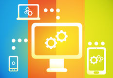 Sync Across Devices. Devices synced together on laptop, tablet, smartphone, and PC Stock Photo