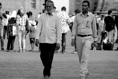 The Sync. Two men walking in a sync shows their strong relationship but still there is something different their feelings their expressions Stock Images