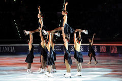 Synchro skaters Shining Blades Stock Images
