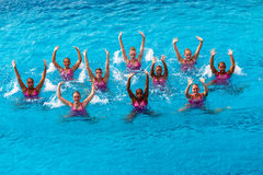 Synchronised Swim Team Dance Action. Synchronized swimming provincial state team  National Aquatic Champs-Kings Park Durban South Africa. Photo image looking Stock Photo