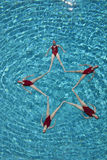 Synchronised Swimmers Forming A Star Shape Stock Photo