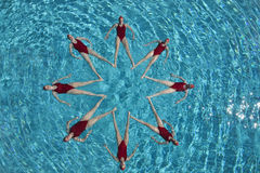 Synchronised Swimmers Forming A Star Shape Royalty Free Stock Images