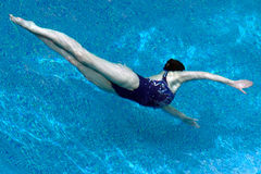 Synchronised swimming. Girl makes a synchronized swimming Royalty Free Stock Image