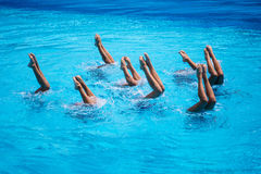 Synchronised Swimming. Women national team synchronized swimming performing at olympic games Stock Photography