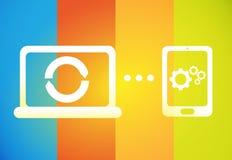 Synchronisierung über Geräten Stockbild