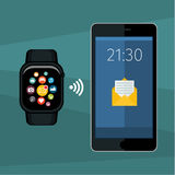 Synchronization between smartwatch and smartphone Stock Photography