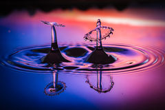 Synchronized Liquid art. The synchronized splashes with reflections Stock Photos