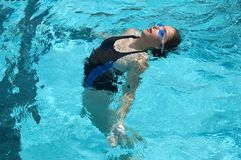 Synchronized Swimmer. During practice in a pool Royalty Free Stock Photos