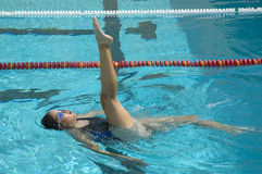 Synchronized Swimmer. During practice in a pool Stock Photos