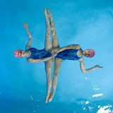 Synchronized swimmers. Hold pose for camera Royalty Free Stock Photos