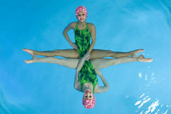Synchronized Swimmers. Hold pose for camera Royalty Free Stock Photo