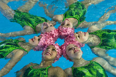 Synchronized swimmers. Hold pose for camera Stock Images