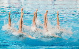 Synchronized swimmers. Synchronized swimming. Synchronized swimmers legs movement Stock Photo