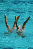 Synchronized swimming duet during competition Stock Photos