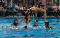 Synchronized swimming exhibition air figure. Spain national olympic synchronized swimming team performs during an exhibition show in the Spanish island of Royalty Free Stock Image