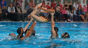 Synchronized swimming exhibition air figure. Spain national olympic synchronized swimming team performs during an exhibition show in the Spanish island of Stock Image