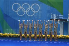 Synchronized swimming of in the Olympic games royalty free stock photography