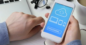 Synchronizing file on all devices using smartphone. Stock footage stock footage