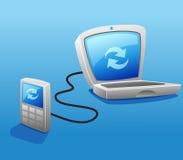 Synchronizing mobile phone with laptop stock photo