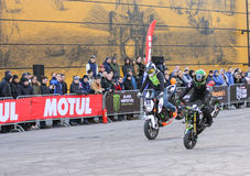 Synchronous execution of mototrucks. Sports motorcycle show of bikers on the open area Royalty Free Stock Image