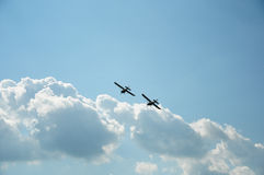 Synchronous flight of two planes Stock Photo