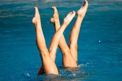 Synchronschwimmenbeine Lizenzfreie Stockbilder