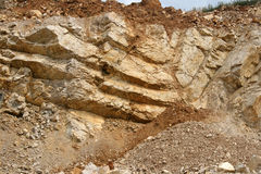 Syncline - geology. Large mine with rocks of organic origin - Limestone royalty free stock image