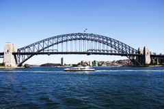 Sydney Harbour Bridge. A view of sydney harbour bridge  from the water heading out on a ferry boat Stock Photography