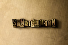 SYNDICATION - close-up of grungy vintage typeset word on metal backdrop Royalty Free Stock Photo