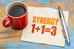Synergy concept on napkin. Synergy concept - word abstract on a napkin with a cup of coffee royalty free stock image
