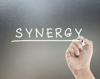 Synergy with hand writing. Synergy text with hand writing Stock Photos