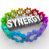 Synergy - People in Gears Around Word Stock Photography