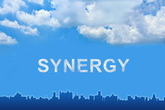 Synergy text on clouds Stock Images