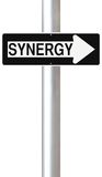 Synergy This Way. A conceptual one way road sign on synergy Stock Image