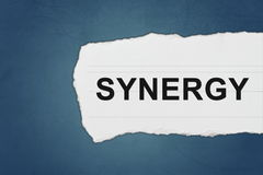 Synergy with white paper tears Royalty Free Stock Image