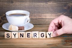 Synergy. Wooden letters on the office desk, informative and communication background.  Royalty Free Stock Photos