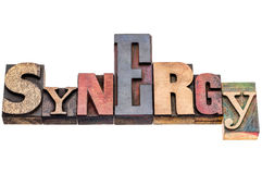Synergy word abstract in wood type Royalty Free Stock Photography