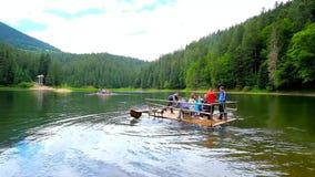 Raft trip to Sea Eye Island on Synevyr Lake, Ukraine. Synevyr, Ukraine - July 1, 2018: Tourists make the raft trip to Sea Eye Island in beautiful Synevyr Lake stock footage