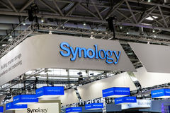 Synology company logo sign on exhibition fair Cebit 2017 in Hannover Messe, Germany. Hannover, Germany - March, 2017: Synology company logo sign on exhibition royalty free stock image