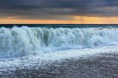 syntas waves för sun för oklarhetskusthav Royaltyfri Foto