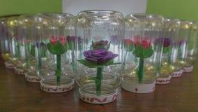 Syntetiska handgjorda blommor Arkivbild