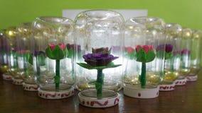 Syntetiska handgjorda blommor Royaltyfri Foto