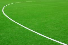 Syntetiskt fotboll eller Footbal fält Royaltyfria Bilder