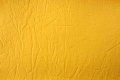 Syntetyczna żółta rzemienna tekstura Obrazy Royalty Free