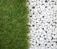 Synthesis grass with white pebbles Royalty Free Stock Photography