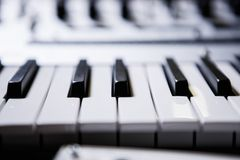Professional midi keyboard for electronic music composer. Synthesizer black and white piano keys.Professional electronic midi keyboard.Audio equipment for music royalty free stock photography