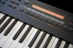 Synthesizer Keyboard. Digital synthesizer with keyboard. LCD screen showing program information Stock Photos