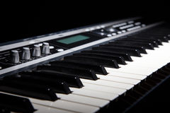 Synthesizer keyboard in shadow Royalty Free Stock Photography